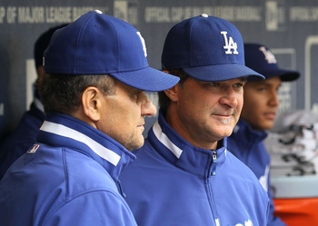 NEW YORK - APRIL 28:  Manager Joe Torre and hitting coach Don Mattingly of the Los Angeles Dodgers look on before their game against the New York Mets on April 28, 2010 at Citi Field in the Flushing neighborhood of the Queens borough of New York City.  (P