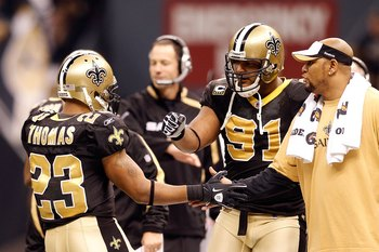 NEW ORLEANS - JANUARY 24:  Pierre Thomas #23 of the New Orleans Saints is congratulated by Will Smith #91 and Deuce McAllister against the Minnesota Vikings during the NFC Championship Game at the Louisana Superdome on January 24, 2010 in New Orleans, Lou