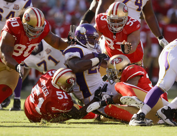 SAN FRANCISCO - AUGUST 22:  Adrian Peterson #28 of the Minnesota Vikings is tackled by the San Francisco 49ers during a preseason game at Candlestick Park on August 22, 2010 in San Francisco, California.  (Photo by Ezra Shaw/Getty Images)