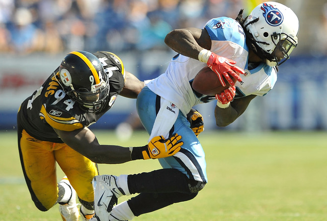 NASHVILLE, TN - SEPTEMBER 19:  Lawrence Timmons #94 of the Pittsburgh Steelers tackles Chris Johnson #28 of the Tennessee Titans at LP Field on September 19, 2010 in Nashville, Tennessee. The Steelers won 19-11.  (Photo by Grant Halverson/Getty Images)