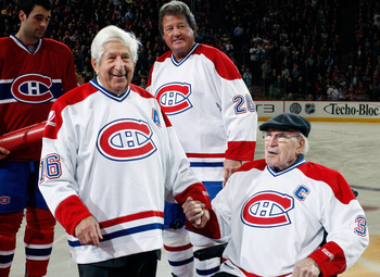 MONTREAL- DECEMBER 4:  Former Montreal Canadiens Elmer Lach and Emile Bouchard are honored by having their numbers retired during the Centennial Celebration ceremonies prior to the NHL game between the Montreal Canadiens and Boston Bruins on December 4, 2