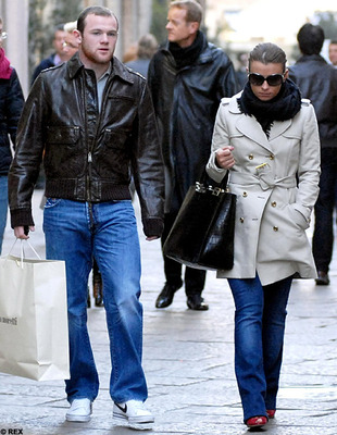 Coleen Rooney in the street ahead of Wayne (Picture)