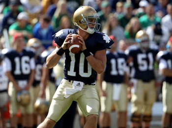 SOUTH BEND, IN - SEPTEMBER 04: Dayne Crist #10 of the Notre Dame Fighting Irish looks for a receiver against the Purdue Boilermakers at Notre Dame Stadium on September 4, 2010 in South Bend, Indiana. Notre Dame defeated Purdue 23-12. (Photo by Jonathan Da