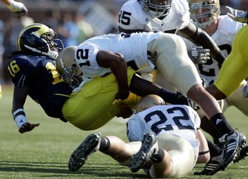 ANN ARBOR, MI - SEPTEMBER 12:  Denard Robinson #16 of Michigan gets tackled by Robert Blanton #12 of Notre Dame at Michigan Stadium on September 12, 2009 in Ann Arbor, Michigan.  (Photo by Domenic Centofanti/Getty Images)