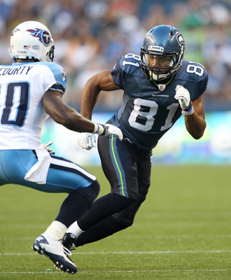 SEATTLE - AUGUST 14:  Wide receiver Golden Tate #81 of the Seattle Seahawks rushes during the preseason game against Jason McCourty #30 of the Tennessee Titans at Qwest Field on August 14, 2010 in Seattle, Washington. (Photo by Otto Greule Jr/Getty Images