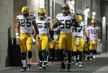 GLENDALE, AZ - JANUARY 10:  Linebacker Nick Barnett #56 of the Green Bay Packers walks with teammates out to the field prior to the 2010 NFC wild-card playoff game against the Arizona Cardinals at the Universtity of Phoenix Stadium on January 10, 2010 in
