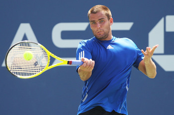 NEW YORK - SEPTEMBER 07:  Mikhail Youzhny of Russia returns a shot against Tommy Robredo of Spain during his men's singles fourth round match on day nine of the 2010 U.S. Open at the USTA Billie Jean King National Tennis Center on September 7, 2010 in the