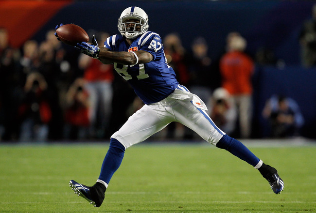 MIAMI GARDENS, FL - FEBRUARY 07: Reggie Wayne #87 reaches for the ball against the Indianapolis Colts of the New Orleans Saints during Super Bowl XLIV on February 7, 2010 at Sun Life Stadium in Miami Gardens, Florida.  (Photo by Jonathan Daniel/Getty Imag