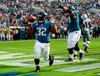 JACKSONVILLE, FL - DECEMBER 13:  Maurice Jones-Drew #32 of the Jacksonville Jaguars celebrates after scoring a touchdown during the game against the Miami Dolphins at Jacksonville Municipal Stadium on December 13, 2009 in Jacksonville, Florida.  (Photo by