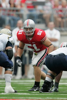 COLUMBUS, OH - SEPTEMBER 8:  Ross Homan #51 of the Ohio State Buckeyes awaits the snap during the game against the Akron Zips at Ohio Stadium on September 8, 2007 in Columbus, Ohio. Ohio State won 20-2. (Photo by David Maxwell/Getty Images)