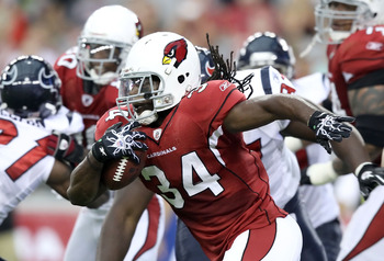 GLENDALE, AZ - AUGUST 14:  Runningback Tim Hightower #34 of the Arizona Cardinals rushes the football against the Houston Texans during preseason NFL game at the University of Phoenix Stadium on August 14, 2010 in Glendale, Arizona.  The Cardinals defeate