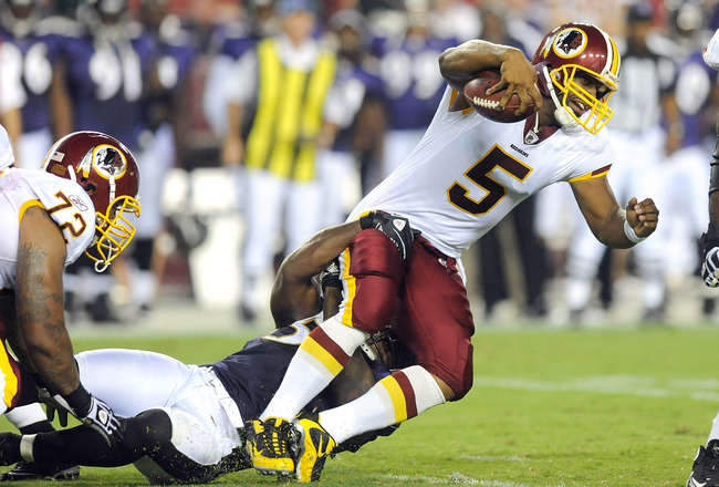 LANDOVER, MD - AUGUST 21:  Donovan McNabb #5 of the Washington Redskins is tackled during the preseason game by Terrell Suggs #55 of the Baltimore Ravens at FedExField on August 21, 2010 in Landover, Maryland.  (Photo by Greg Fiume/Getty Images)