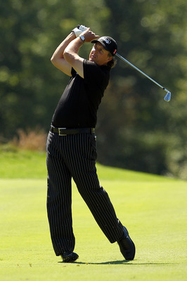 NORTON, MA - SEPTEMBER 06:  Phil Mickelson hits a shot on the second hole during the final round of the Deutsche Bank Championship at TPC Boston on September 6, 2010 in Norton, Massachusetts.  (Photo by Mike Ehrmann/Getty Images)