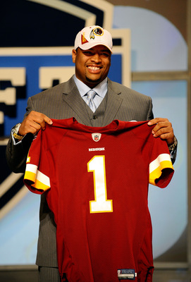 NEW YORK - APRIL 22:  Trent Williams (R) of the Oklahoma Sooners holds a Washington Redskins jersey after Washington selected Williams #4 overall ini the first round during the 2010 NFL Draft at Radio City Music Hall on April 22, 2010 in New York City.  (