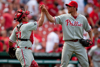 ST. LOUIS - JULY 22: Brad Lidge #54 and Carlos Ruiz #51 both of the Philadelphia Phillies congratulate each other after beating the St. Louis Cardinals at Busch Stadium on July 22, 2010 in St. Louis, Missouri. The Phillies defeated the Cardinals 2-0.  (Ph