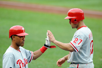 WASHINGTON - AUGUST 01:  Placido Polanco #27 of the Philadelphia Phillies is congratulated by Wilson Valdez #21 after scoring in the seventh inning against the Washington Nationals at Nationals Park on August 1, 2010 in Washington, DC.  (Photo by Greg Fiu