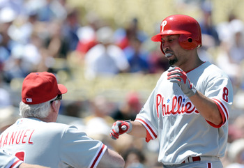 LOS ANGELES, CA - SEPTEMBER 01:  Shane Victorino #8 of the Philadelphia Phillies celebrates his solo homerun with Manager Charlie Manuel #41 off of Clayton Kershaw #22 of the Los Angeles Dodgers for a 2-0 lead during the second inning at Dodger Stadium on