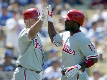 LOS ANGELES, CA - SEPTEMBER 01:  Jimmy Rollins #11 of the Philadelphia Phillies celebrates his run with Placido Polanco #27 off of a Chase Utley #26 double for a 3-0 lead over the Los Angeles Dodgers during the seventh inning at Dodger Stadium on Septembe