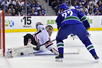 VANCOUVER, CANADA - MAY 5:  Goalie Antti Niemi #31 of the Chicago Blackhawks stops Daniel Sedin #22 of the Vancouver Canucks in close during the first period in Game Three of the Western Conference Semifinals during the 2010 NHL Stanley Cup Playoffs on Ma
