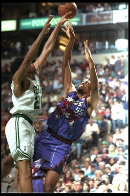 12 Apr 1996:  Center Acie Earl of the Toronto Raptors and Pervis Ellison of the Boston Celtics fight for the ball during a game played at the Fleet Center in Boston, Massachusetts.  The Celtics won the game, 136-108. Mandatory Credit: ALLSPORT USA  /Allsp