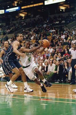 21 Nov 1997:  Guard Chauncey Billups of the Boston Celtics (right) in action against forward Jayson Williams of the New Jersey Nets during a game at the Fleet Center in Boston, Massachusetts.  The Celtics won the game 101-93. Mandatory Credit: Jamie Squir