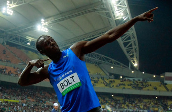 DAEGU, SOUTH KOREA - MAY 19:  Usain Bolt of Jamaica celebrates after winning the men's 100 metre race during the Colorful Daegu Pre-Championships Meeting 2010 at Daegu Stadium on May 19, 2010 in Daegu, South Korea. Bolt won the race at 9.86.  (Photo by Ch