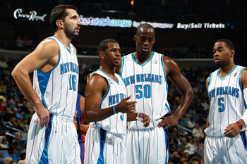 NEW ORLEANS - DECEMBER 16:  Peja Stojakovic #16, Chris Paul #3 Emeka Okafor #50 and Marcus Thornton #5 of the New Orleans Hornets talk  during the game against the Detroit Pistons at New Orleans Arena on December 16, 2009 in New Orleans, Louisiana. The Ho