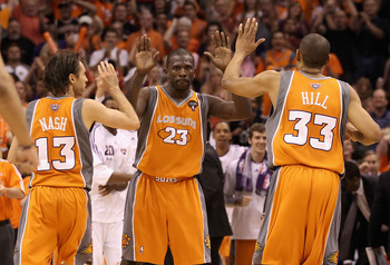 PHOENIX - MAY 05:  Jason Richardson #23 of the Phoenix Suns high fives teammates Steve Nash #13 and Grant Hill #33 after scoring against the San Antonio Spurs during Game Two of the Western Conference Semifinals of the 2010 NBA Playoffs at US Airways Cent