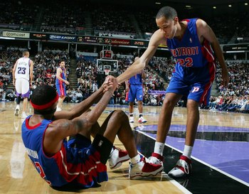 SACRAMENTO, CA - NOVEMBER 8:  Richard Hamilton #32 of the Detroit Pistons is helped off the floor by teammate Tayshaun Prince #22 during the game against the Sacramento Kings at Arco Arena on November 8, 2006 in Sacramento, California. The Kings won 99-86