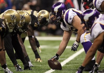 NEW ORLEANS - JANUARY 24:  Offensive center John Sullivan #65 of the Minnesota Vikings gets set to snap the ball against the New Orleans Saints during the NFC Championship Game at the Louisiana Superdome on January 24, 2010 in New Orleans, Louisiana. The
