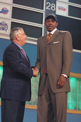 27 Jun 2001: Joe Johnson of Arkansas is greeted by NBA Commissioner Davd Stern after being picked 10th in the NBA Draft by the Boston Celtics at Madison Square Garden in New York City. Mandatory Credit: Al Bello/ALLSPORT NOTE TO USER: It is expressly unde