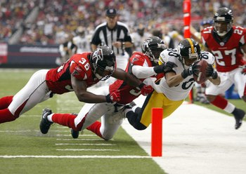 ATLANTA - OCTOBER 22: Cedrick Wilson #80 of the Pittsburgh Steelers leaps for the goal line against lawyer Milloy #36 of the Atlanta Falcons on October 22, 2006 at the Georgia Dome in Atlanta, Georgia. (Photo by Doug Pensinger/Getty Images)