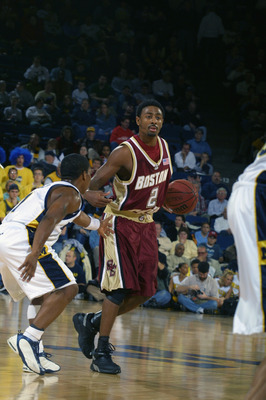 ANN ARBOR, MI - DECEMBER 1:  Guard Troy Bell #2 of the Boston College Eagles dribbles the ball against guard Avery Queen #1 of the Michigan Wolverines during the game at Crisler Arena in Ann Arbor, Michigan on December 1, 2001.  Boston College defeated Mi