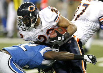 DETROIT - JANUARY 03: Matt Forte #22 of the Chicago Bears is tackled during a fourth quarter run by Anthony Henry #32 of the Detroit Lions on January 3, 2010 at Ford Field in Detroit, Michigan. Chicago won the game 37-23. (Photo by Gregory Shamus/Getty Im
