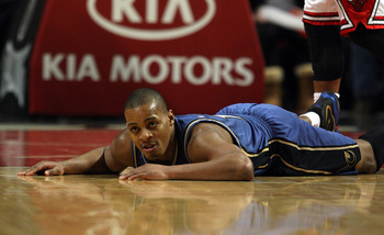CHICAGO - JANUARY 15: Randy Foye #15 of the Washington Wizards lays on the floor after turning over the ball against the Chicago Bulls at the United Center on January 15, 2010 in Chicago, Illinois. The Bulls defeated the Wizards 121-119 in double overtime