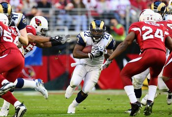 GLENDALE, AZ - DECEMBER 27:  Runningback Chris Ogbonnaya #22 of the St. Louis Rams rushes the ball against the Arizona Cardinals during the third quarter of the NFL game at the Universtity of Phoenix Stadium on December 27, 2009 in Glendale, Arizona. The