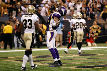 NEW ORLEANS - SEPTEMBER 09: Visanthe Shiancoe #81 of the Minnesota Vikings celebrates after he scored a 20-yard touchdown reception in the second quarter against Jabari Greer #33 of the New Orleans Saints at Louisiana Superdome on September 9, 2010 in New