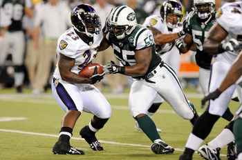 BALTIMORE - AUGUST 24:   Willis McGahee #23 of the Baltimore Ravens is tackled by Jamaal Westerman of the New York Jets during a preseason game at M&T Bank Stadium on August 24, 2009 in Baltimore, Maryland.  (Photo by Greg Fiume/Getty Images)