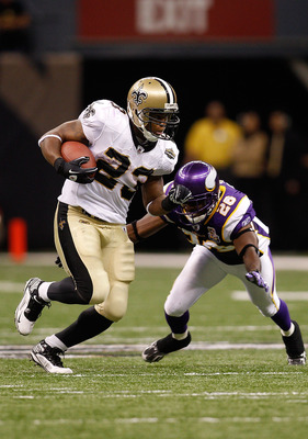 NEW ORLEANS - SEPTEMBER 09:  Pierre Thomas #23 of the New Orleans Saints runs the ball against Antoine Winfield #26 of the Minnesota Vikings in the second half at Louisiana Superdome on September 9, 2010 in New Orleans, Louisiana. The Saints won 14-9.  (P