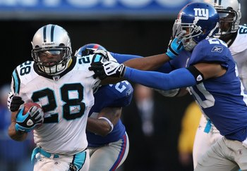 EAST RUTHERFORD, NJ - DECEMBER 27:  Jonathan Stewart #28 of the Carolina Panthers rushes against the New York Giants at Giants Stadium on December 27, 2009 in East Rutherford, New Jersey.  (Photo by Nick Laham/Getty Images)