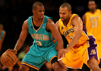 LOS ANGELES, CA - NOVEMBER 6:  Chris Paul #3 of the New Orleans Hornets controls the ball as he is guarded by Derek Fisher #3 of the Los Angeles Lakers on November 6, 2007 at Staples Center in Los Angeles, California.  The Hornets won 118-104.   NOTE TO U