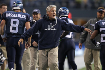 SEATTLE - AUGUST 21:  Head coach Pete Carroll of the Seattle Seahawks congratulates players after the Seahawks scored a touchdown in the first half during the preseason game against the Green Bay Packers at Qwest Field on August 21, 2010 in Seattle, Washi
