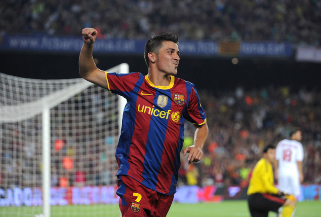 BARCELONA, SPAIN - AUGUST 25:  David Villa of Barcelona celebrates after scoring Barcelona's first goal during the Joan Gamper Trophy match between Barcelona and AC Milan at Camp Nou stadium on August 25, 2010 in Barcelona, Spain.  (Photo by Denis Doyle/G