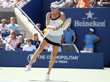 NEW YORK - SEPTEMBER 08:  Vera Zvonareva of Russia returns a shot against Kaia Kanepi of Estonia during her women's singles quarterfinal match on day ten of the 2010 U.S. Open at the USTA Billie Jean King National Tennis Center on September 8, 2010 in the