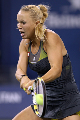 NEW YORK - SEPTEMBER 08:  Caroline Wozniacki of Denmark returns a shot against Dominika Cibulkova of Slovakia during her women's single quarterfinal match during day ten of the 2010 U.S. Open at the USTA Billie Jean King National Tennis Center on Septembe