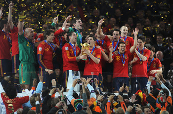 Sergio Ramos and David Villa clutch the World Cup Trophy