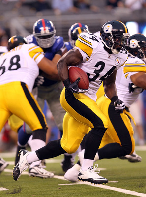 EAST RUTHERFORD, NJ - AUGUST 21: Rashard Mendenhall #34 of the Pittsburgh Steelers rushes against the New York Giants during their preseason game at New Meadowlands Stadium on August 21, 2010 in East Rutherford, New Jersey.  (Photo by Nick Laham/Getty Ima