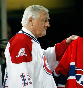 MONTREAL- DECEMBER 4:  Former Montreal Canadien Dickie Moore and Gordie Howe hold up a Maurice Richard Canadiens jersey during the Centennial Celebration ceremonies prior to the NHL game between the Montreal Canadiens and Boston Bruins on December 4, 2009