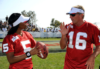 MALIBU, CA - JULY 24:Singer Kelly Rowland gets tips from Joe Montana, athlete at the Madden NFL 10 Pigskiin Pro-Am on Xbox 360 event  on July 24, 2009 in Malibu, California.  (Photo by Frazer Harrison/Getty Images)