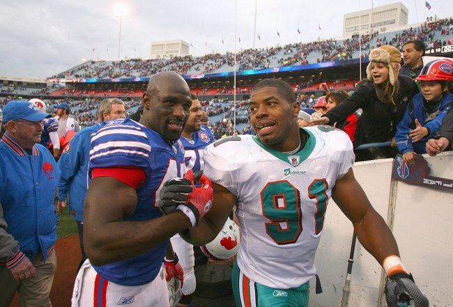 ORCHARD PARK, NY - NOVEMBER 29:  Bryan Scott #43 of the Buffalo Bills greets Cameron Wake #91 of the Miami Dolphins after the game at Ralph Wilson Stadium on November 29, 2009 in Orchard Park, New York. Buffalo won 31-14. (Photo by Rick Stewart/Getty Imag